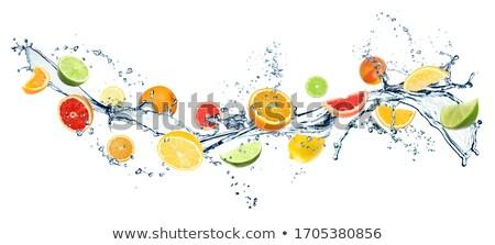 Stock photo: Splashing fruit on water.