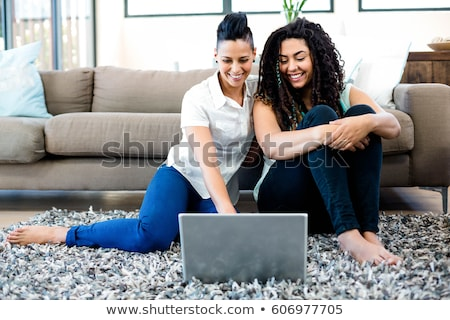 Loving lesbian couple at home Stock photo © stokkete