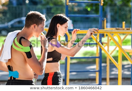 young woman touches man's abs Stock photo © feedough