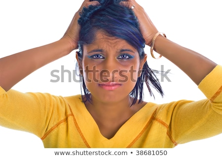 Frustrated Indian young woman screaming pulling her hair Stock photo © bmonteny