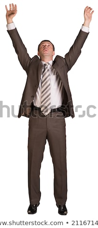 Businessman holding hands up in front of him Stock photo © cherezoff