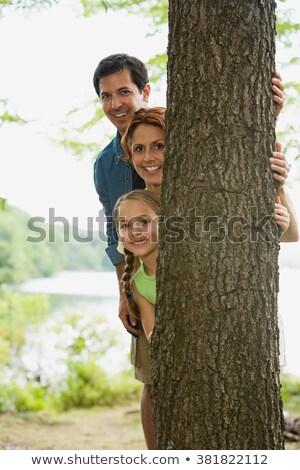 Mulher em torno de árvore atrás cedro Foto stock © Habman_18