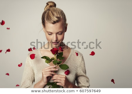 beautiful woman smelling rose stock photo © anna_om