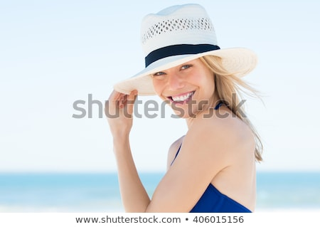 Beautiful girl in bikini and straw hat looking at camera on beac Stock photo © wavebreak_media