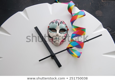 Carnival Mask on Clock Showing Eleven Minutes after Eleven Stock photo © stickasa