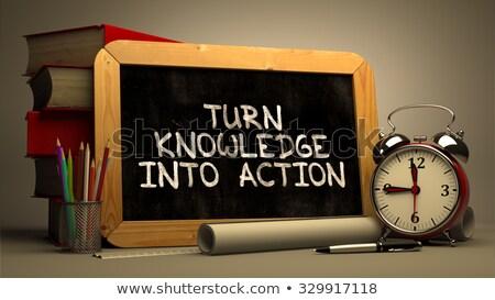 turn knowledge into action handwritten on chalkboard stock photo © tashatuvango