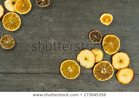 dried lemon slices on rusty dark wooden table stock photo © nessokv