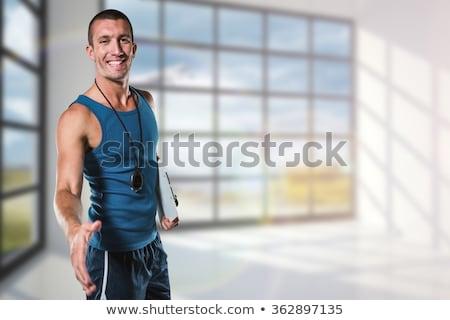 Composite image of happy personal trainer giving handshake Stock photo © wavebreak_media
