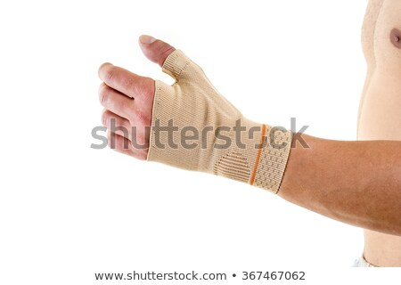 man wearing flexible wrist brace in studio stock photo bela hoche belahoche 6670576. Black Bedroom Furniture Sets. Home Design Ideas