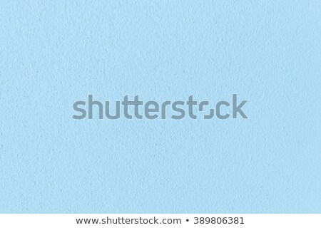 Close up of blue rough texture wall coating. Stock photo © latent