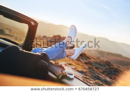 Pretty woman driving her convertible sports car with her sunglasses Stock photo © zurijeta