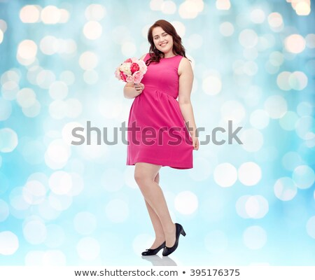 happy young plus size woman with flower bunch Stock photo © dolgachov