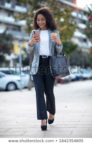Сток-фото: деловая · женщина · ходьбе · вниз · улице · Smart