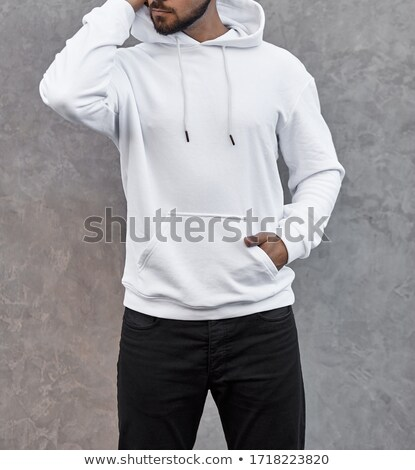 man with hoodie on holding hand on neck Stock photo © feedough
