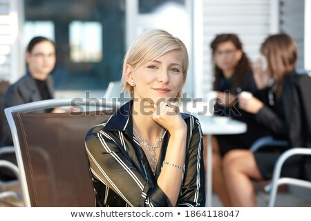 black businesspeople seated on chair stock photo © szefei