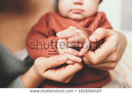 Close-up of happy Mother hugging Baby's feet her Newborn baby gi Stock photo © Victoria_Andreas