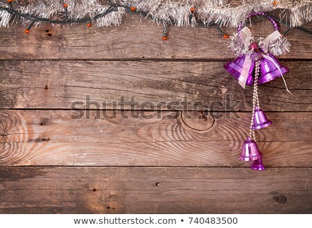 Christmas decorations. Purple bells and electrical garland on wo Stock photo © user_11056481