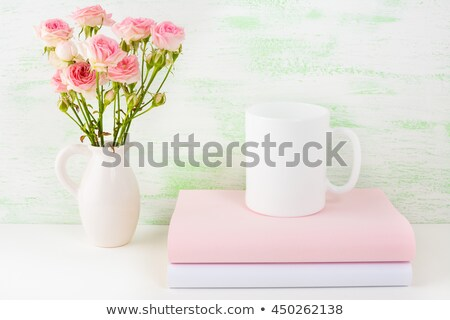 Coffee Mug Mockup With Pink Roses Photo stock © TasiPas
