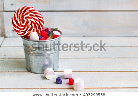 Colorful candies in a small bucket on light wooden background wi Stock photo © Yatsenko