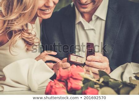 young bride holding a wedding ring in a box stok fotoğraf © rastudio