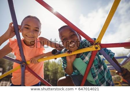 肖像 · 笑みを浮かべて · 少女 · 座って · ドーム · 学校 - ストックフォト © wavebreak_media