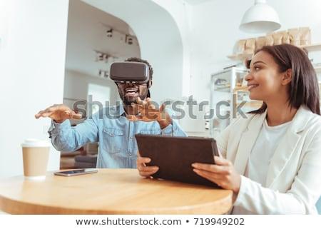 vrouw · hoofdtelefoon · technologie · gezicht · gelukkig · venster - stockfoto © stokkete
