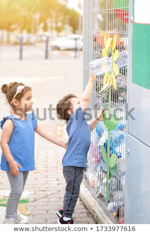 Two kids throwing trash on the street Stock photo © bluering