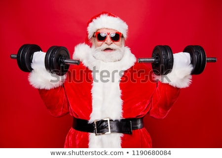 Strong Santa Claus and dumbbells. Christmas fitness. Dumbbell pr Stock photo © MaryValery