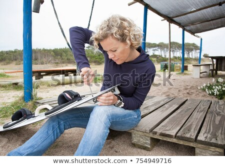 woman applying fin to her kiteboard Stock photo © IS2