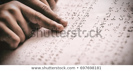 Cropped image of child reading braille book Stock photo © wavebreak_media