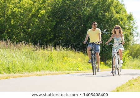 Couple cycling along country road Stock photo © IS2