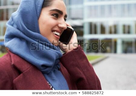 Közel-keleti üzletasszony beszél telefon kívül iroda Stock fotó © monkey_business