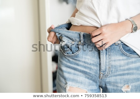 Mujer suelto jeans afro fondo blanco Foto stock © IS2