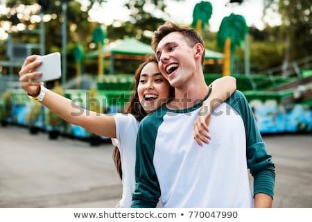 Adolescente Coppia parco di divertimenti femminile maschio romance Foto d'archivio © IS2