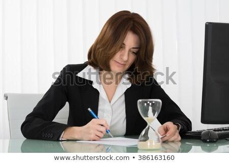 Onderneemsters papieren werken laat kantoor business Stockfoto © dolgachov
