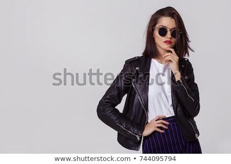 Belle brunette posant noir veste rayé Photo stock © acidgrey