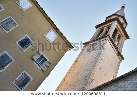 Church tower with clock on facade in Budva in Montenegro Stock photo © bezikus