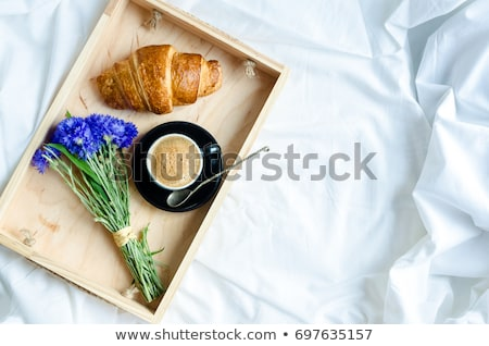good morning continental breakfast on white bed sheets stock photo © illia