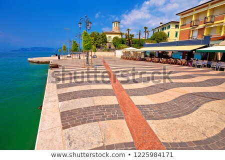 Garda lake turquoise waterfront in town of of Lasize view Stock photo © xbrchx
