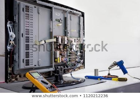 Technikus javít televízió nő ül kanapé Stock fotó © AndreyPopov