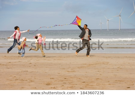 Mixed Race Young Girl Sisters Outdoors with Family Behind Stock photo © feverpitch