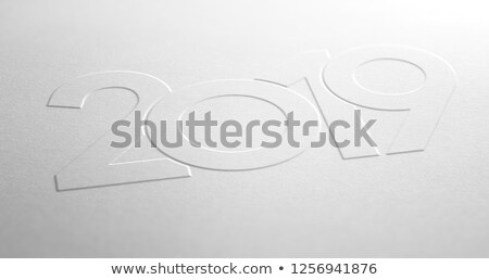 Year 2019 Design Embossed on White Paper Background Stock photo © olivier_le_moal