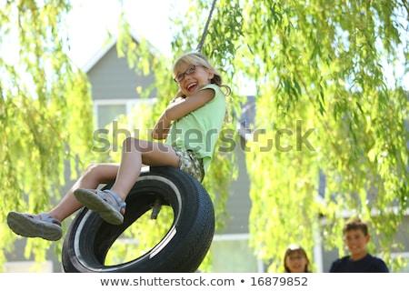 portrait · fille · pneu · Swing · arbre · heureux - photo stock © Lopolo