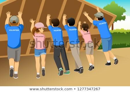Groupe bénévoles bâtiment maison ensemble illustration Photo stock © artisticco