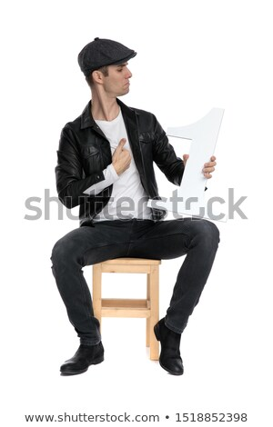 seated man holds number one letter and looks to side Stock photo © feedough