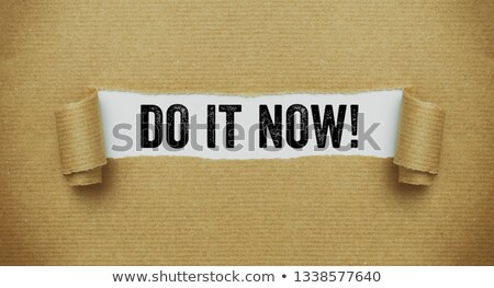 Stock photo: Torn brown paper revealing the words Do it now