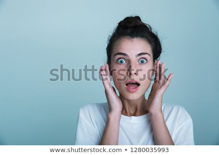 Close up of a shocked young woman wearing tank shirt Stock photo © deandrobot