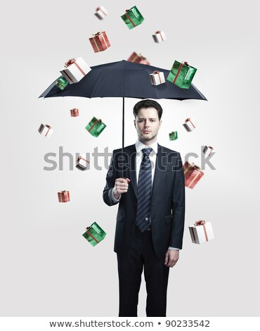 conceptual portrait of a young businessman falling down from the Stock photo © konradbak