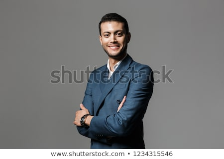Photo stock: Image Of Joyful Arabic Businessman 30s In Formal Suit Smiling Wh