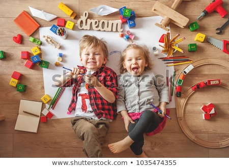 Boy and Girl Playing With Paints and Blocks Stock photo © Krisdog